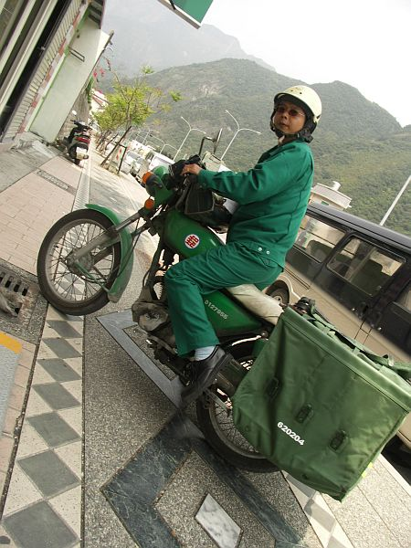 Photo - Postman on his bike in Taroko